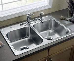 New Kitchen faucets and disposals installed by ANS Plumbing