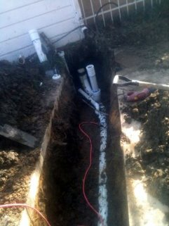 new pipes under driveway install by ANS Plumbing